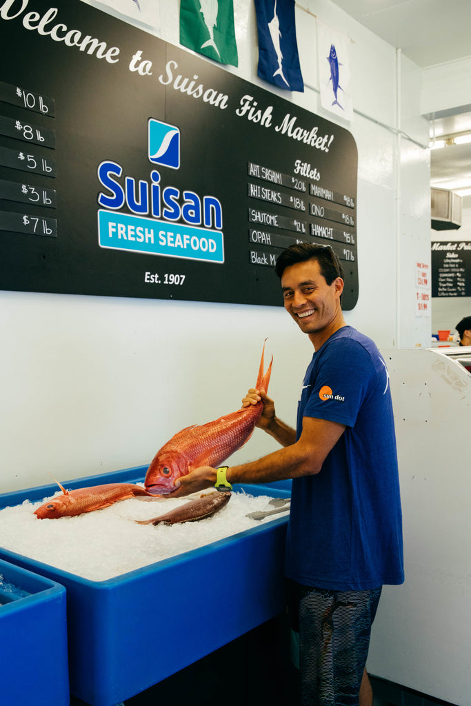 Robert Patterson of Hilo holds the fresh catch of the day at Suisan Fish Market in collaboration with Sundot Marine Flags