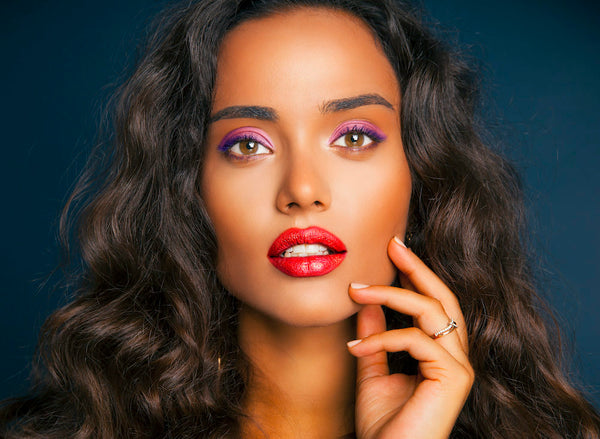 Dark Complexion Woman Wearing Red Lipstick - Mademoiselle Magazine.