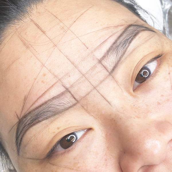 Eyebrow mapping for microblading.