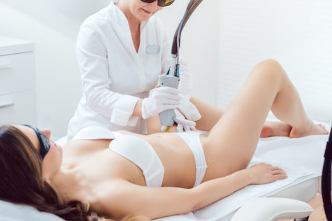 Woman receiving Brazilian laser hair removal treatments from an experienced technician.
