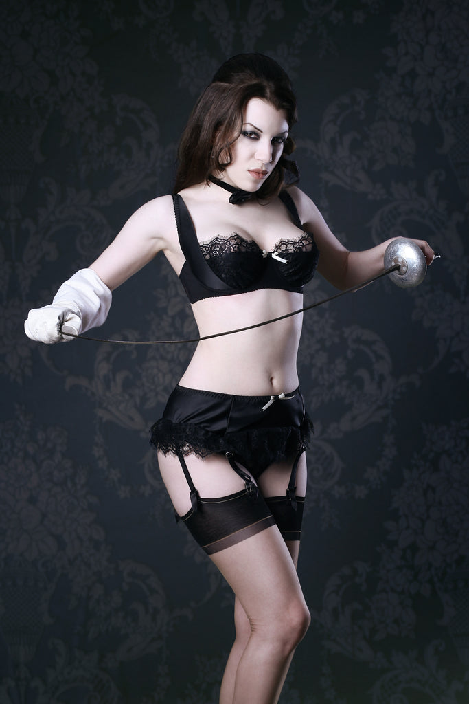 Retro black satin 1/4 cup bra set with vintage background and fencing foil