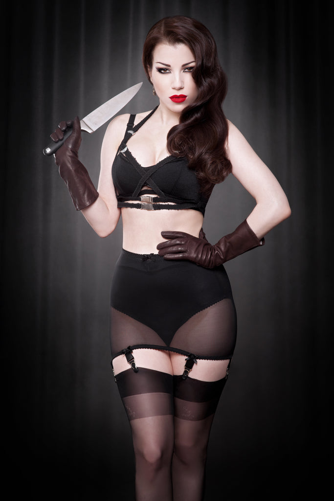 Retro Strappy Harness in black elastic with wide metal clips worn by model styled for vintage film noir