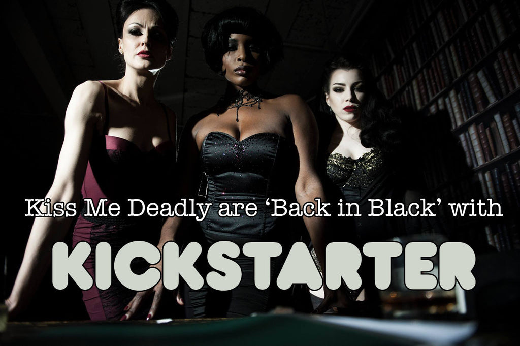Three models stare you down in film noir lighting, wearing retro, 50's styled lingerie and corsets. A kickstarter logo is underneath.