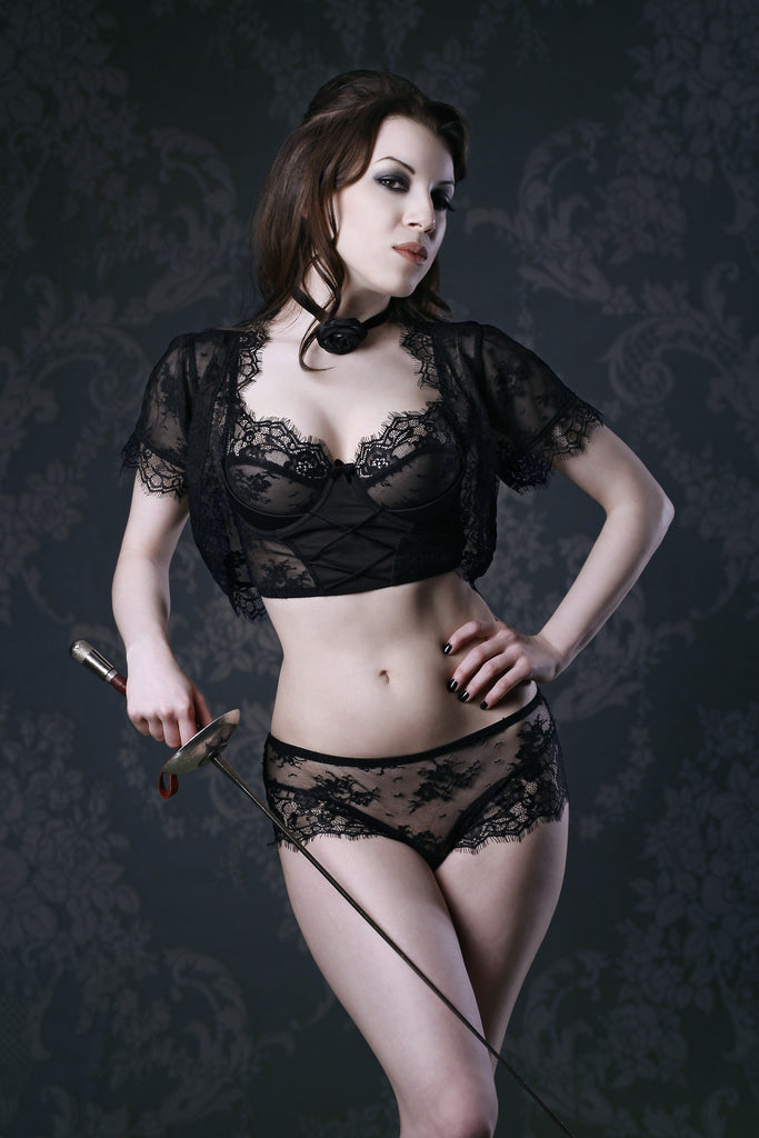 Vintage Dior inspired black lace bra, short and bolero shrug with retro background and fencing accessories