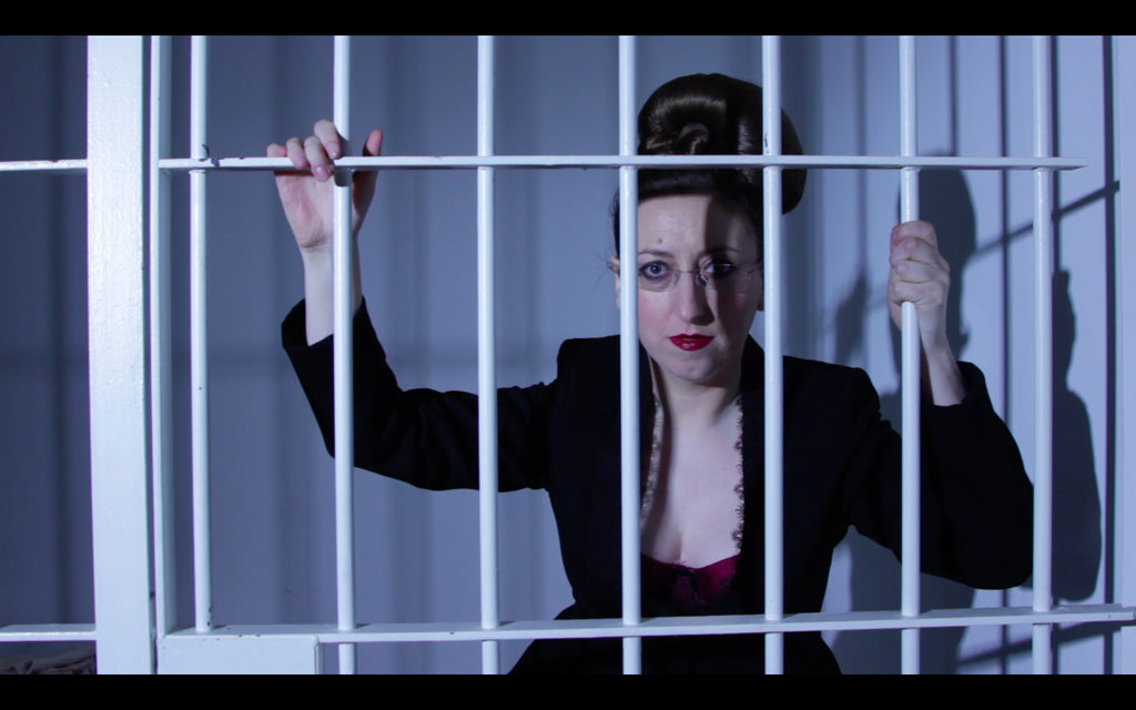Catherine (the founder of Kiss Me Deadly) appears to be behind bars
