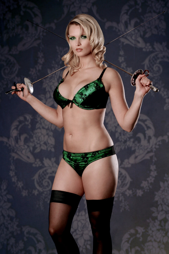 Retro emerald green satin and black lace bra set with vintage background and fencing foils
