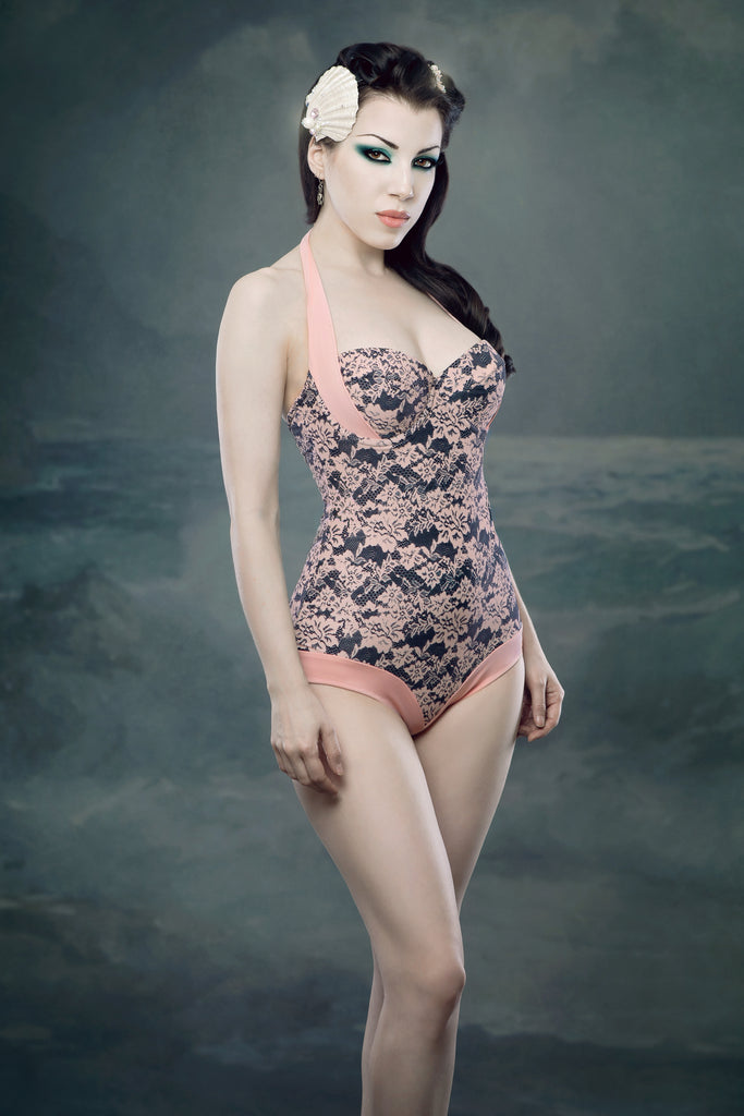 Retro one piece deluxe swimsuit with lace print in pale peach pink and black photographed in the style of vintage little mermaid