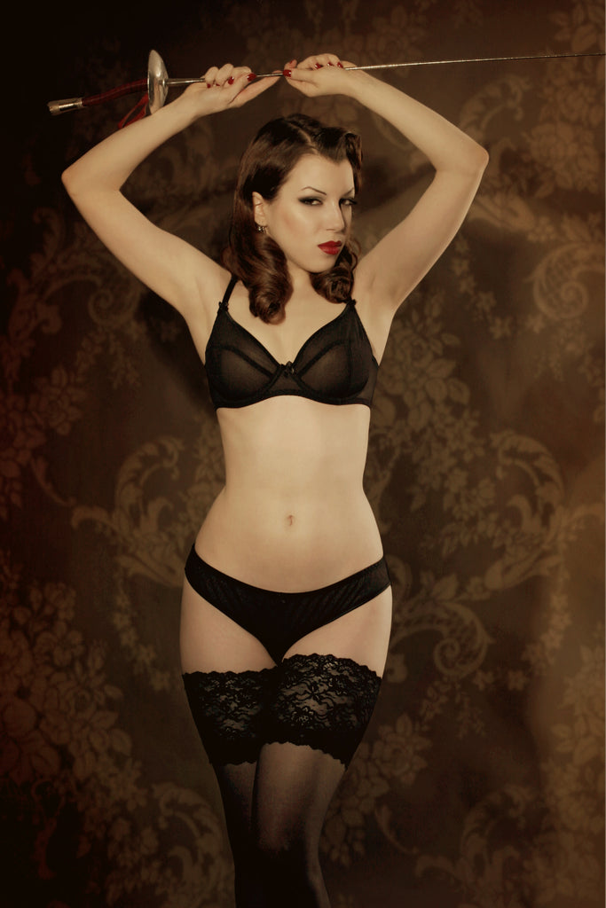 Retro sheer black bra set with vintage sepia background and fencing accessories