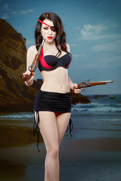 Retro red and black skirted bikini with vintage pirate pistols