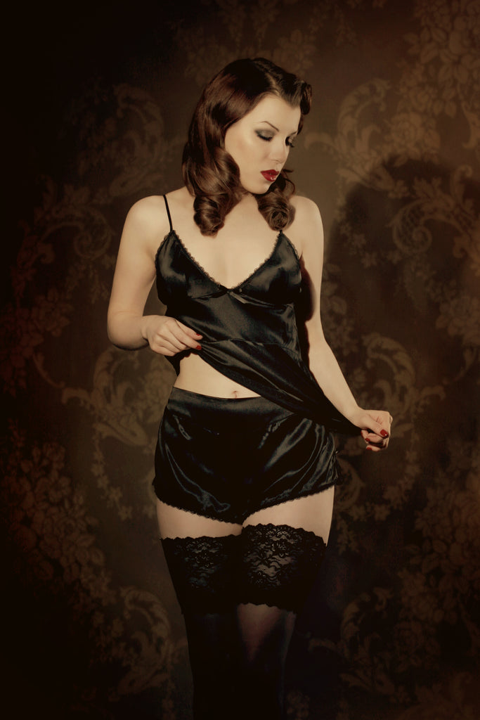 Retro black silk camisole and tap pant french knicker on vintage sepia background