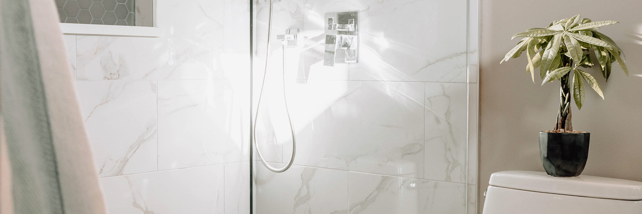 Clean marble tiles in a well-light bathroom