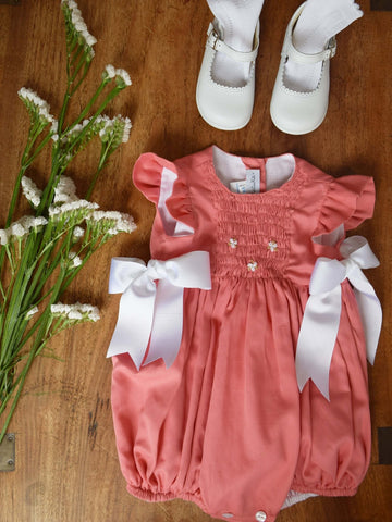 Coral romper with side bows