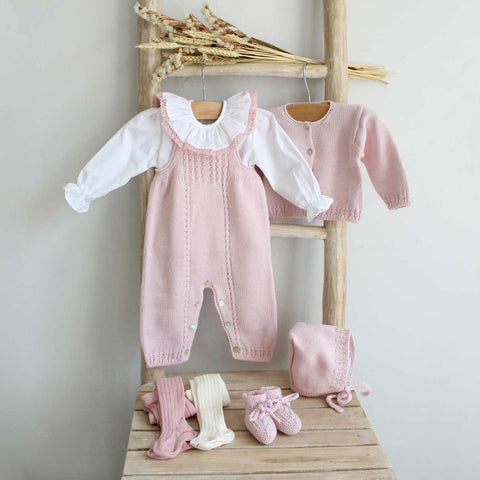 Hand knitted overall in pink