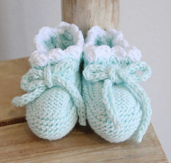 Knitted booties in mint green