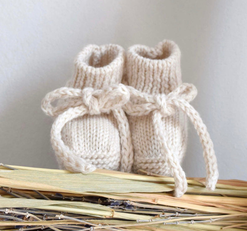Knotted booties in cream