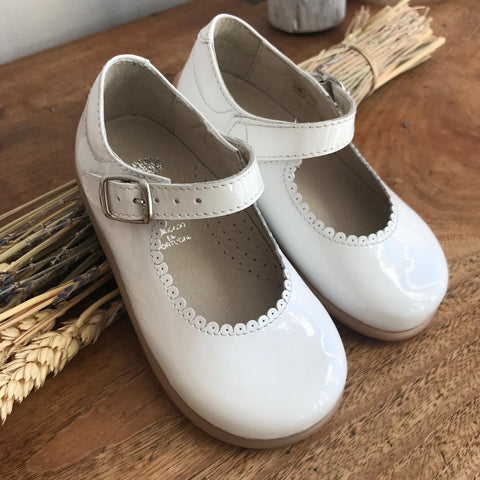 White patent leather Mary Jane shoes