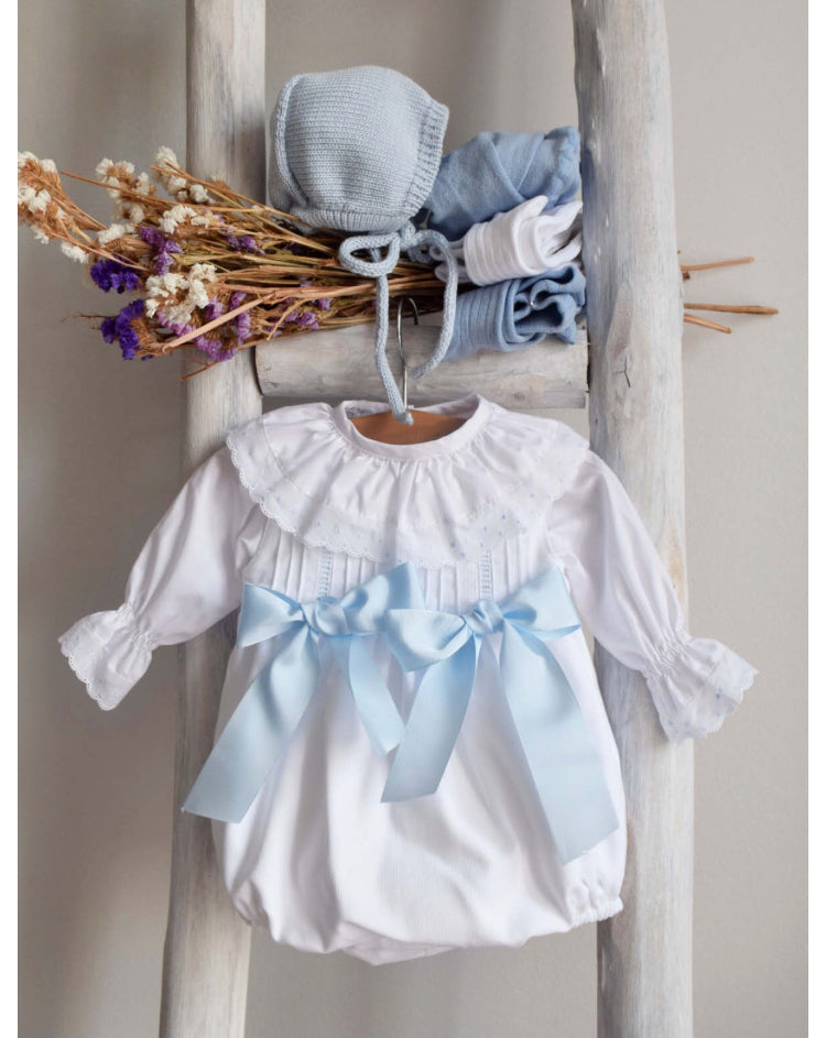 White romper with blue bows