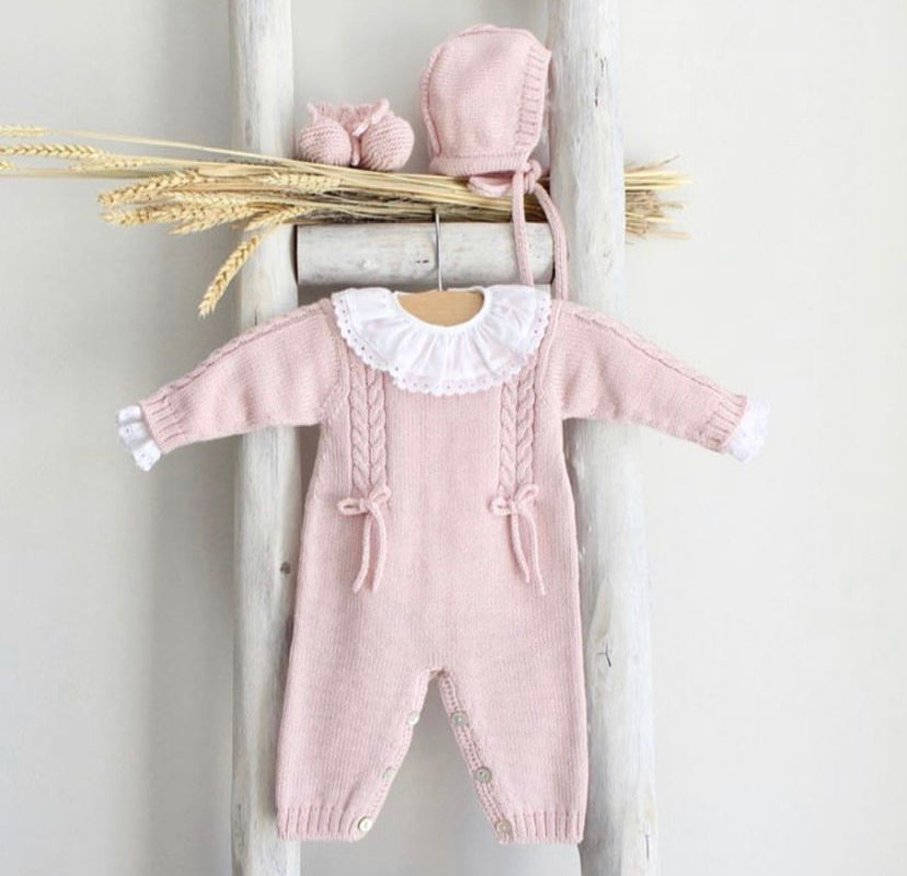Pink knitted overall with bows
