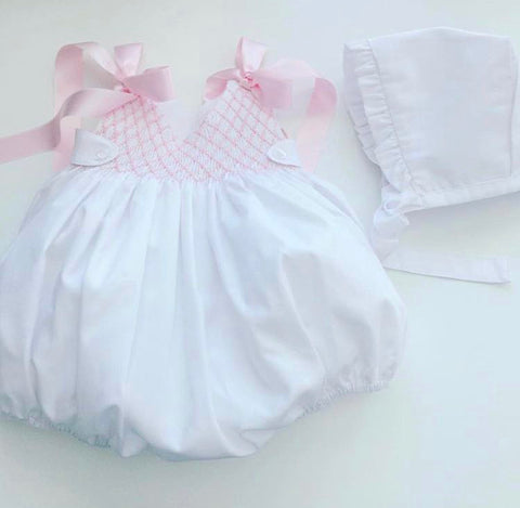 White smocked romper with pink bows