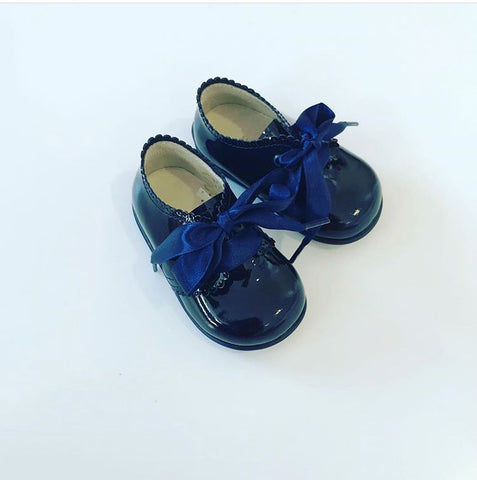 Blue boots with ribbon laces