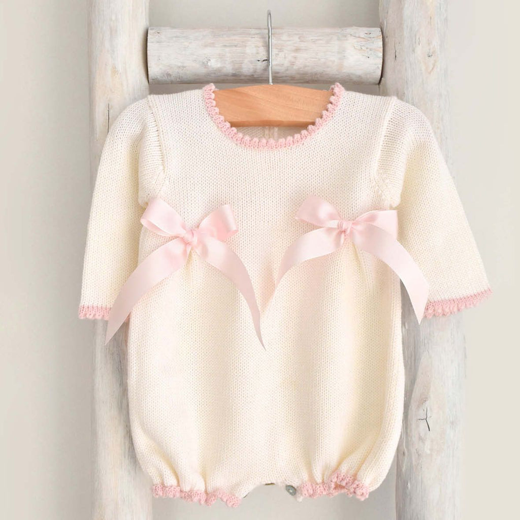 Wool romper with pink bows