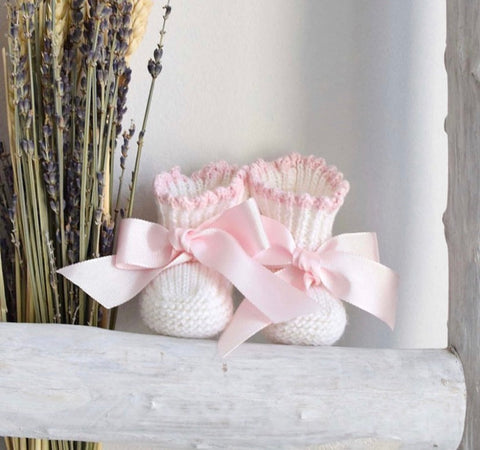 Baby booties in cream and pink