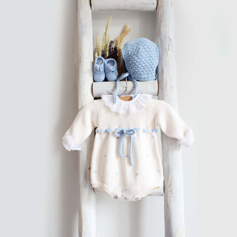 Knitted romper in cream and blue
