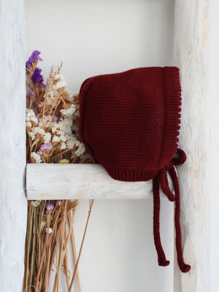 Burgundy knitted bonnet