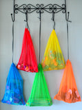 Brightly coloured mesh storage bags
