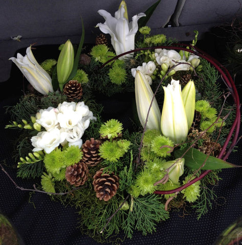 Special Christmas Wreath in fresh flowers, cones and foliage