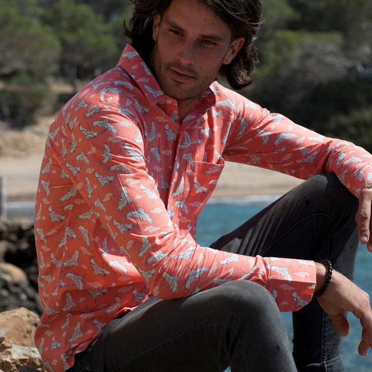 Man wearing a cotton summer shirt with birds print from Frangipani. British designer menswear from The Mantique Winchester