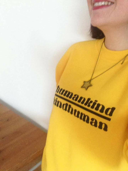 Adult slogan jumper with the words humnakind kind human across the chest