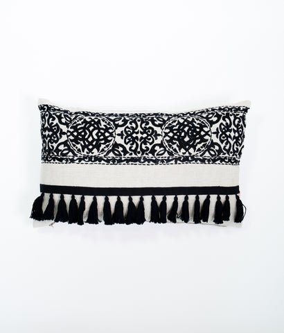 Nomad natural and black tassel cushion