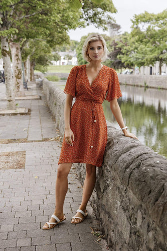 Rowen Avenue Dresses Wrap Dress in Orange Print