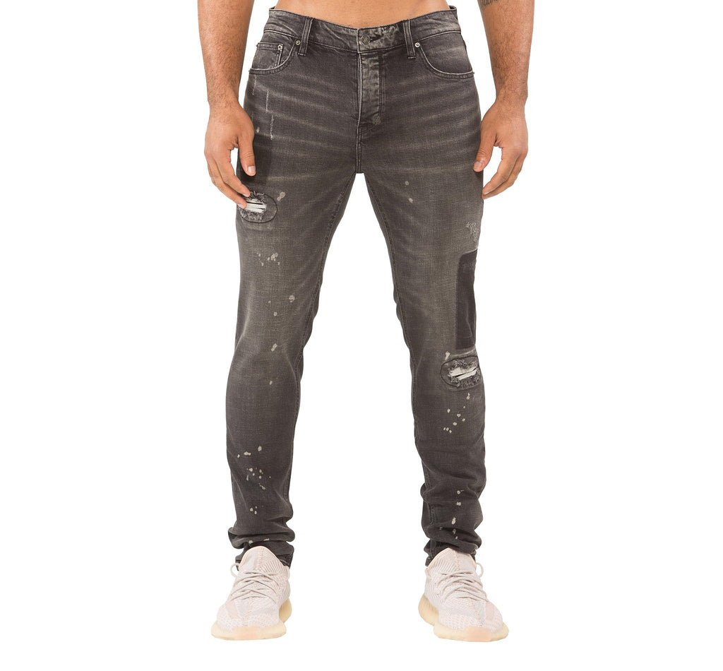 Model wearing Barcelona distressed washed men's black skinny jeans & Yeezy Boost 350 sneakers