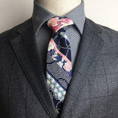 The Cherry Shibori necktie tied in a perfect Pratt knot, AKA the Shelby knot.