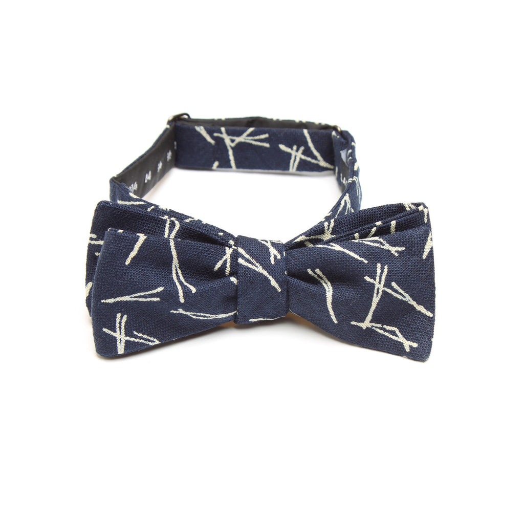 This handmade batwing bow tie by Olaf Olsson is made of Japanese cotton that has a wonderful pine needle pattern from Japan. The Indigo Matsu bow tie is great neckwear.