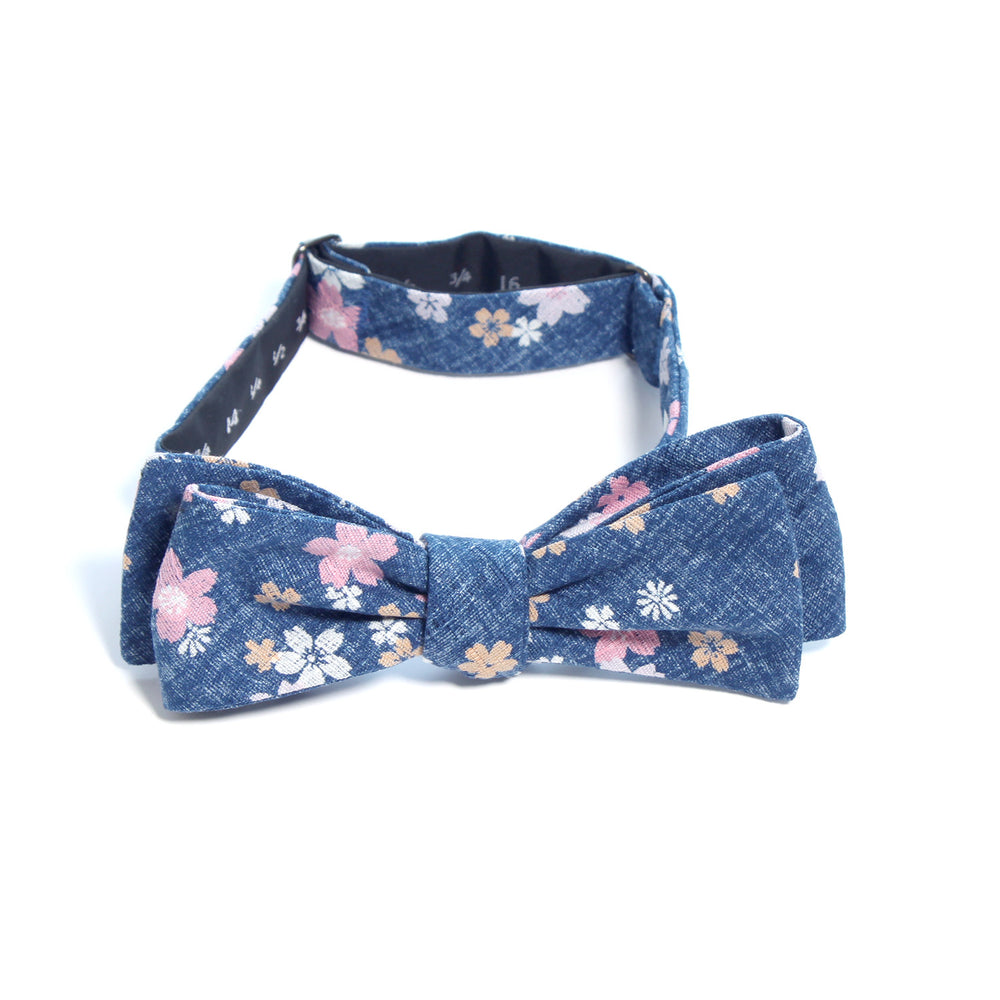 This handmade batwing bow tie by Olaf Olsson is made of Japanese cotton that has a colorful floral pattern from Japan. The Little Flowers bow tie is great neckwear.