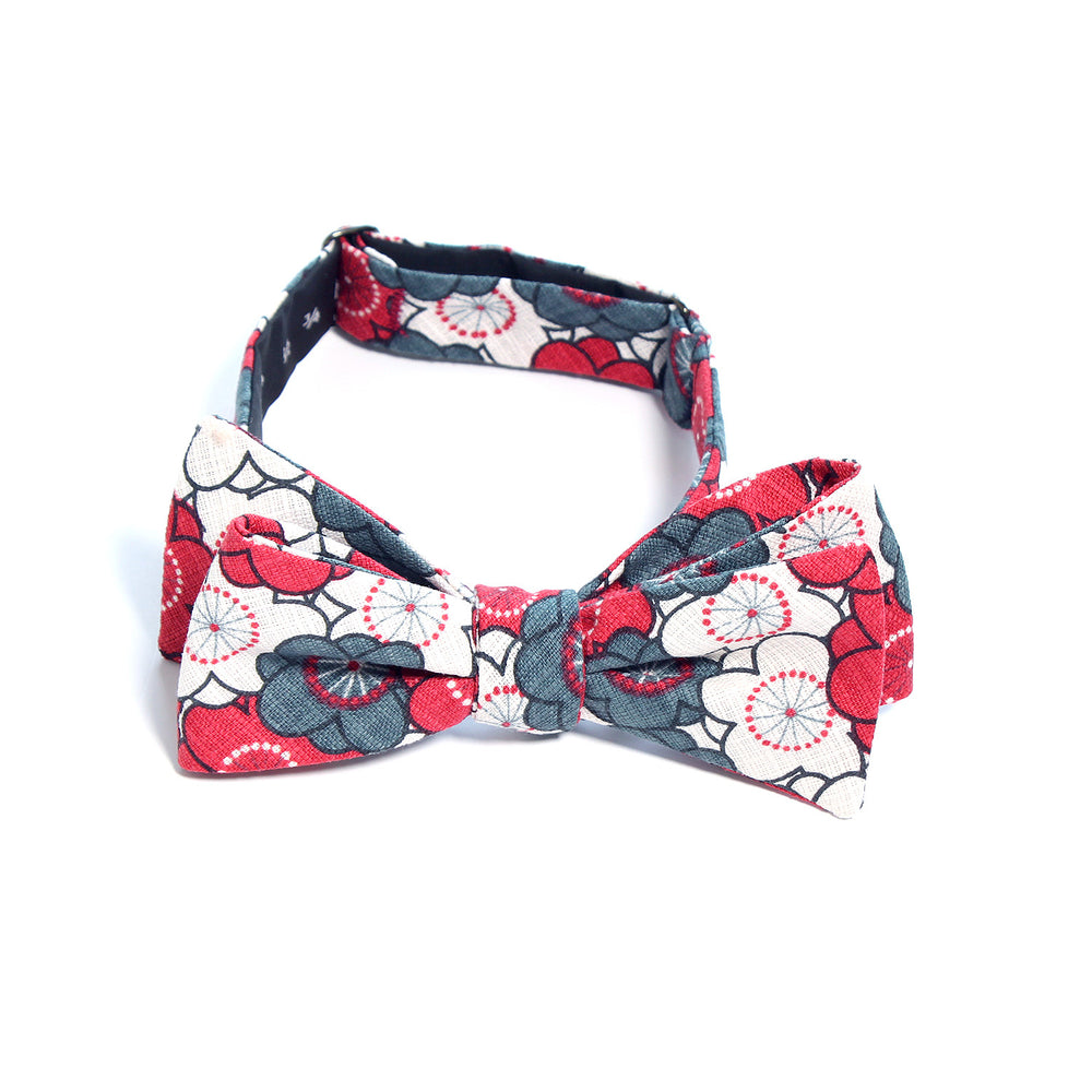 This handmade batwing bow tie by Olaf Olsson is made of Japanese cotton that has a bright floral pattern plum flowers from Japan. The Steel Ume bow tie is great neckwear.