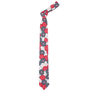 The Steel Ume necktie is a thin necktie from Olaf Olsson made from Japanese fabric with a floral print of plum flowers in grey and red from Japan. It is beautiful neckwear.