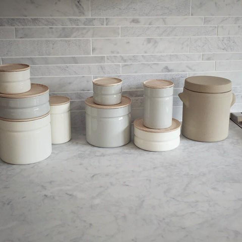 Enamel Kitchen Canisters And One French Stoneware Container