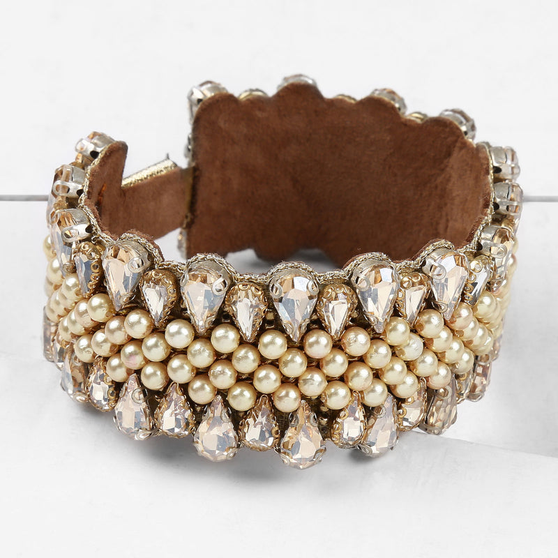 Deepa by Deepa Gurnani Handmade Roxie Cuff Gold on Wood Background