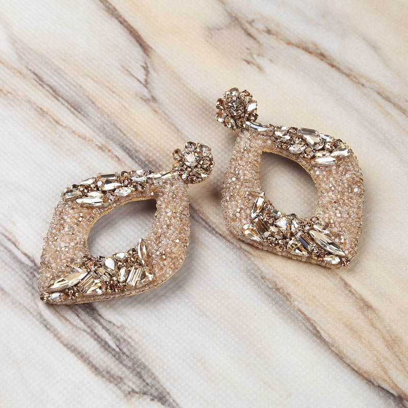 Deepa Gurnani Handmade René Earrings in Gold on Marble Background