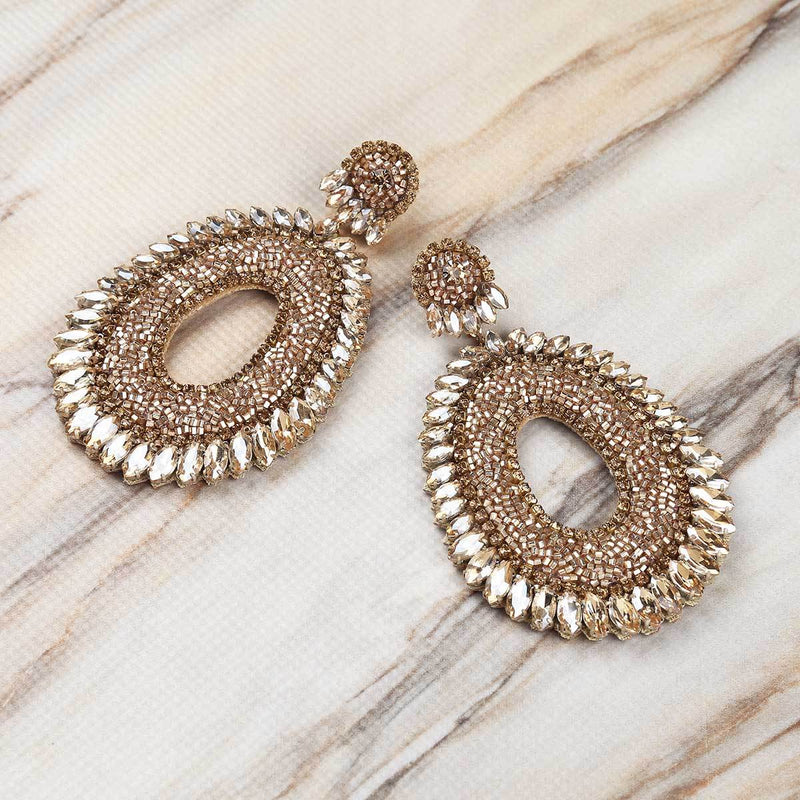 Deepa Gurnani Handmade Kiki Earrings in Gold on Marble Background