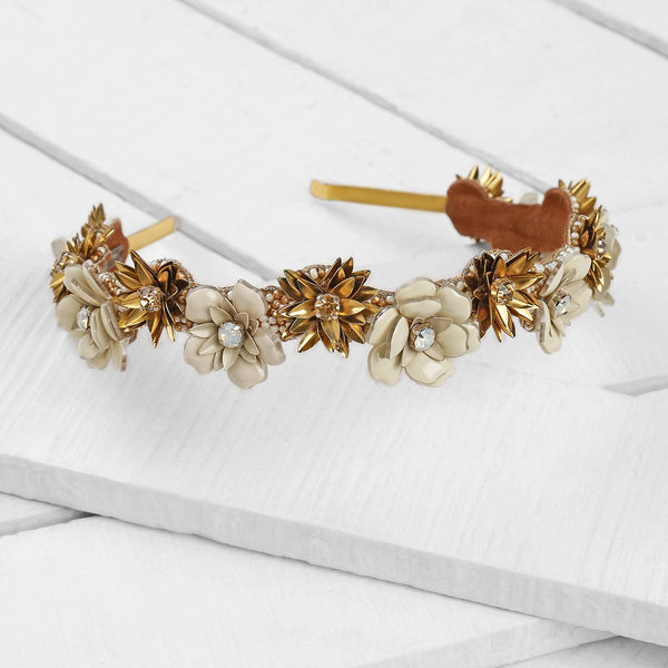 Deepa by Deepa Gurnani Handmade Blessie Headband in Gold on Wood Background