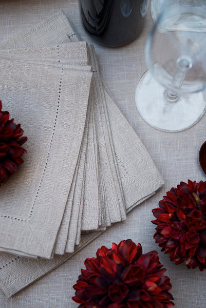 Natural linen napkins in beige, hemstitch. For Nordic or Scandinavian Style Christmas table setting.