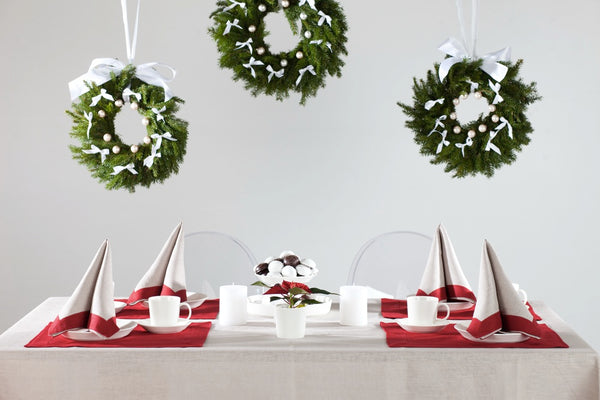 Scandinavian style Christmas Table. Nordic Style Dining Table Setting. Natural linen tablecloth, pure linen napkins and placemats.