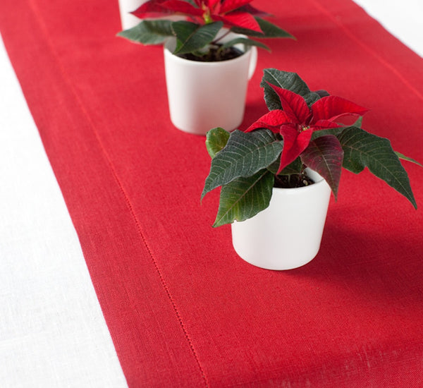 Red linen table runners for Scandinavian or Nordic Style Christmas Table Decor.