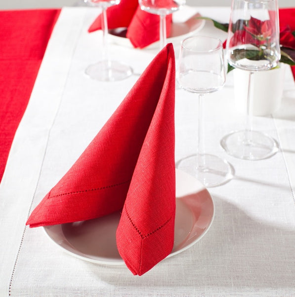 Authentic Nordic style table setting with pure linen napkins - red and white Scandinavian Christmas Table Decor.