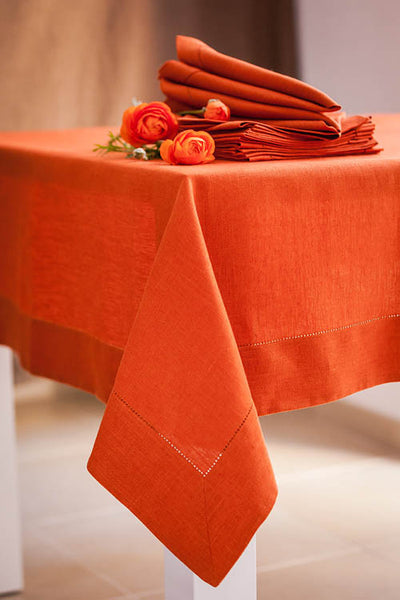 Deep and warm orange natural linen tablecloth in large sizes. Fast and cheap shipping worldwide